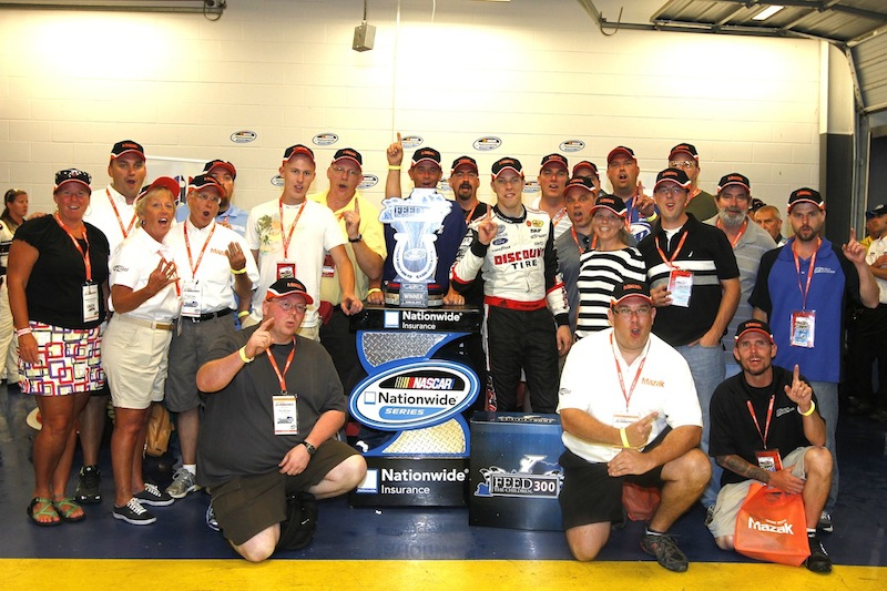Mazak employees gather with Brade Keselowski after his Feed the Children 300 victor at Kentucky Speedway in July.
