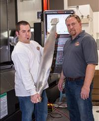 Justin Carter (left) and Craig Barhorst (right) with propeller machined on the shop's Mazak INTEGREX e-420HS that they expect will slash machining cycle times for propellers by as much as 50%.